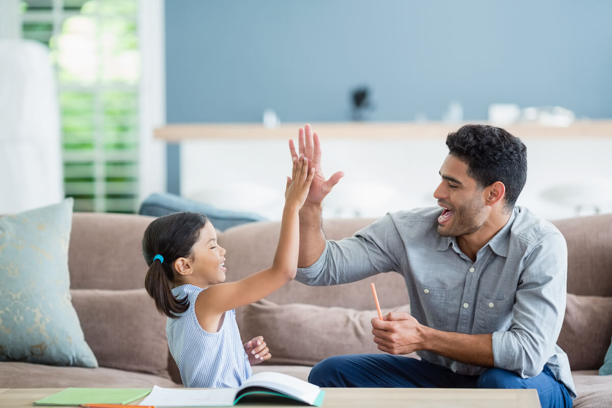 Father giving daughter highfive