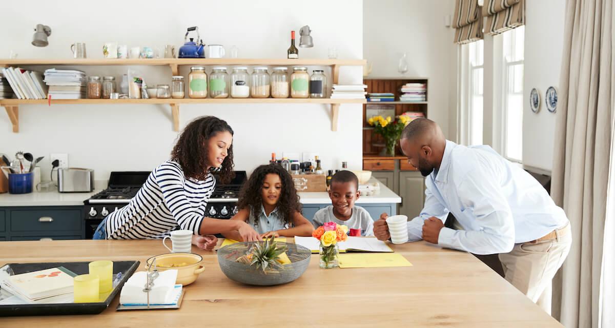 Family doing homework in the kitchen