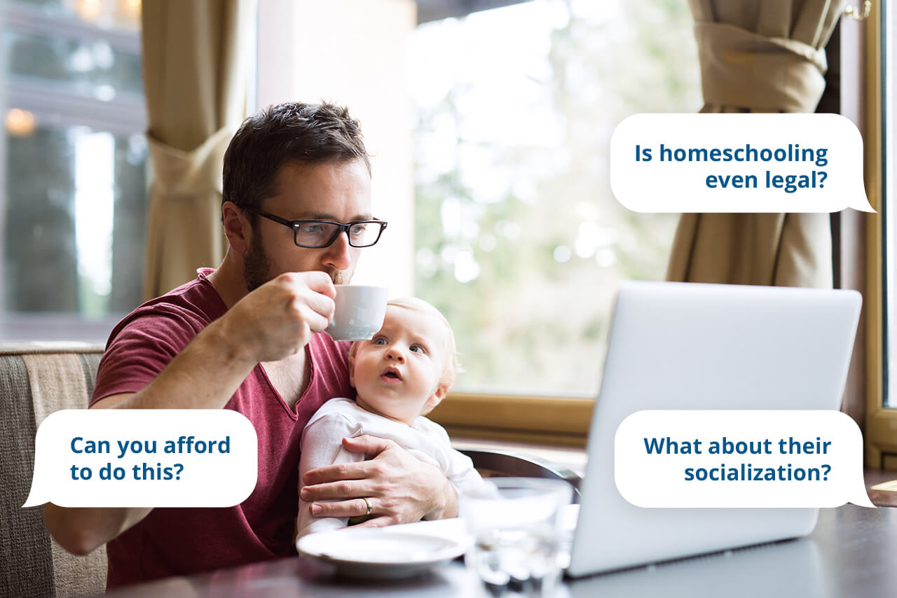 Father with child on laptop trying to answers homeschooling questions.